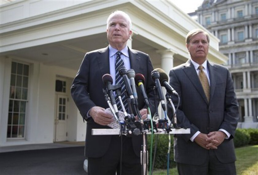 "FILE - In this Sept. 2, 2013, file photo Sen. John McCain, R-Ariz., with Sen. Lindsey Graham, R-S.C., right, speaks with reporters outside the White House in Washington after a closed-door meeting about Syria with President Barack Obama. In a statement released Saturday, Sept. 14, 2013, McCain and Graham said a Syrian chemical weapons agreement is meaningless. They said friends and enemies of the U.S. will view the deal, reached between the U.S. and Russia Saturday, as ""an act of provocative wea"