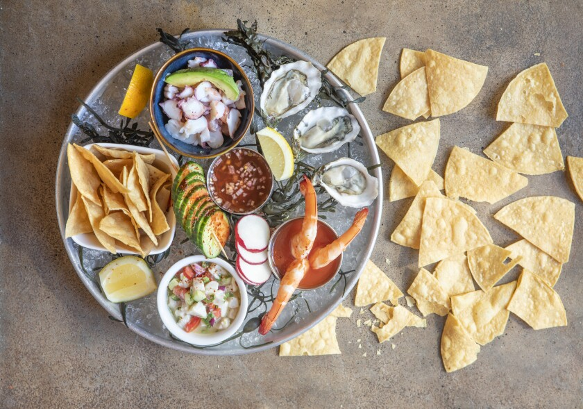 The Baja seafood platter with oysters, chipotle mignonette, ensalada mixta, Mexicali ceviche, shrimp campechana, seasonal veggies and tortilla chips from Socalo.