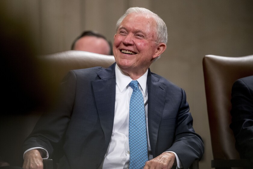 FILE - In this May 9, 2109, file photo, former Attorney General Jeff Sessions smiles during a farewell ceremony for Deputy Attorney General Rod Rosenstein in the Great Hall at the Department of Justice in Washington. Sessions is exploring the possibility of a run for his former Senate seat in Alabama. Two people with knowledge of Sessions' thinking say he has made telephone calls exploring the possibility of running for old Senate seat. (AP Photo/Andrew Harnik, File)