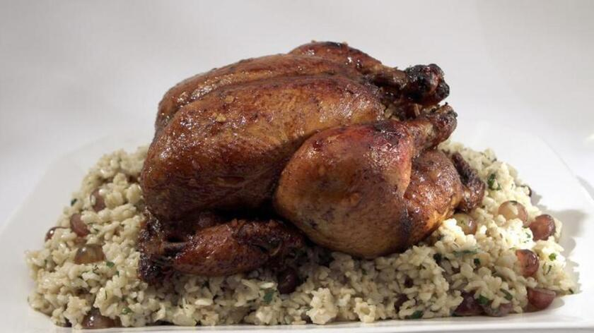 A Rosh Hashana main dish could be chicken marinated with pomegranate molasses, honey and spices and stuffed with brown rice. Recipe