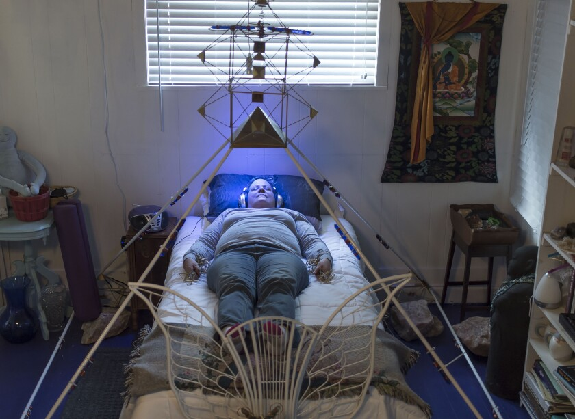 Lori Carter, a local medium, has color therapy treatment at the Cassadaga Spiritualist Camp.