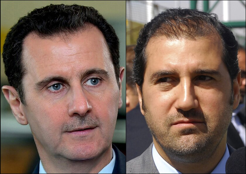 Syrian President Bashar Assad, left, and cousin Rami Makhlouf, one of the country's wealthiest businessmen.