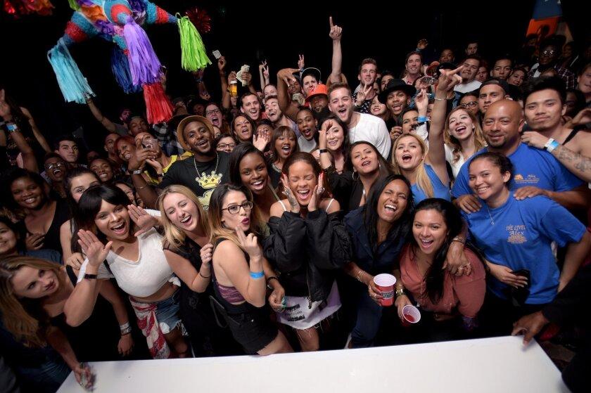 Singer Rihanna took a few dozen fans on a mysterious journey to watch her new music video Wednesday night.