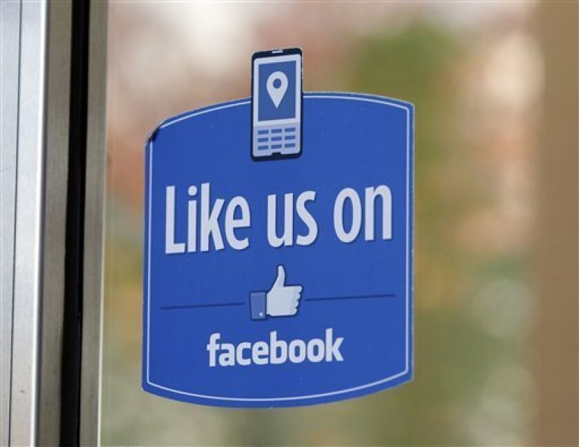 "FILE - This Dec. 13, 2011 file photo shows a sign at Facebook headquarters in Menlo Park, Calif. Facebook, the social network that changed ""friend"" from a noun to a verb, is expected to file as early as Wednesday, Feb. 1, 2012, to sell stock on the open market. Its debut is likely to be the most talked-about initial public offering since Google in 2004. (AP Photo/Paul Sakuma, file)"