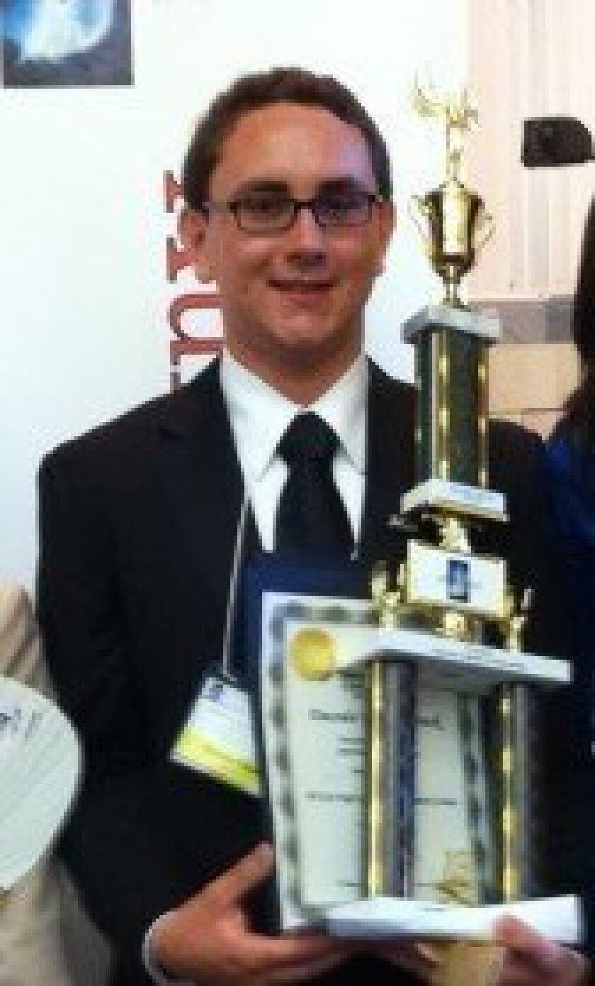 Torrey Pines High School senior Dacoda Strack with his award.