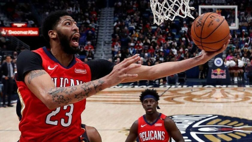 Pelicans forward Anthony Davis puts up a shot during a game against the Heat.