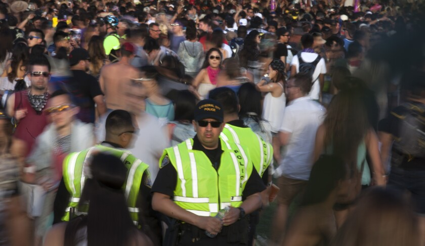 Cathedral City police officers keep an eye on the crowds of festivalgoers at the Coachella Valley Music and Arts Festival in 2015.