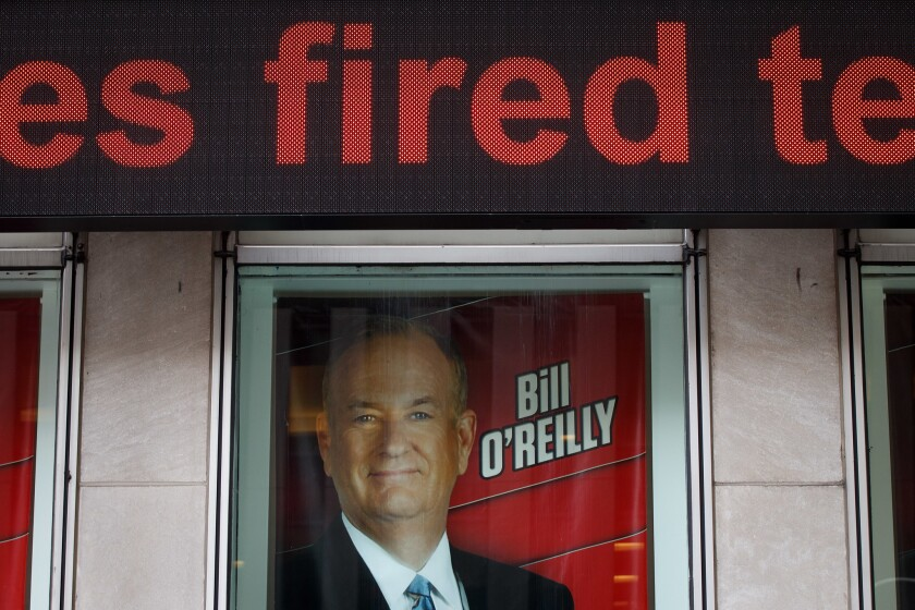 Advertisements for Fox News and Bill O'Reilly stand in a window outside of the News Corp. and Fox News headquarters in Midtown Manhattan on April 19, 2017, in New York City.