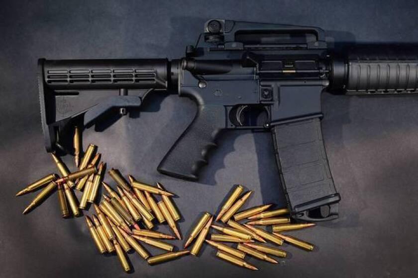A Rock River Arms AR-15 rifle, similar to the Bushmaster used by Adam Lanza in the Newtown, Conn., massacre, is shown with ammunition.