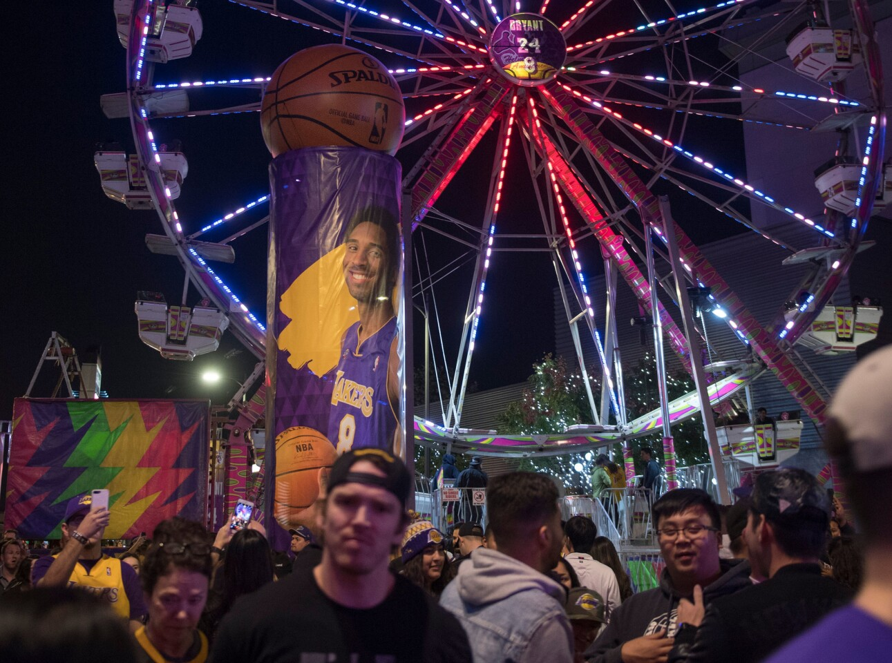 Dec 18, 2017; Los Angeles, CA, USA; Fans pack an amusement area set up in front of Staples Center to commemorate former Laker great Kobe Bryant having his uniform numbers retired during halftime of the Lakers game against the Golden State Warriors. Mandatory Credit: Robert Hanashiro-USA TODAY Sports ** Usable by SD ONLY **