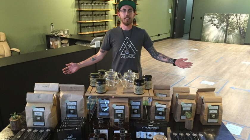 Jeremy Haley, 30, stands inside the Artisan's Apothecary in Denver, where he hopes to sell kratom, a plant used to treat drug addiction and other ailments.
