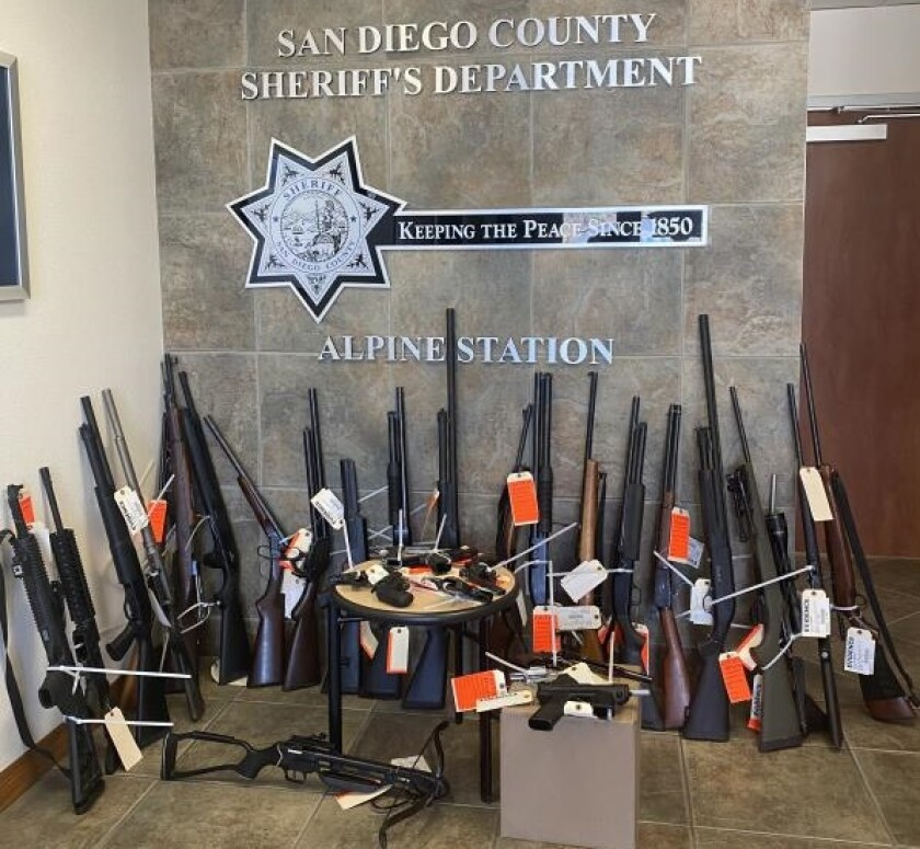 Sheriff's deputies seized 32 guns from the home of a man who allegedly fired a shotgun toward deputies.