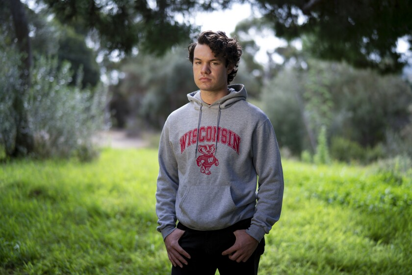 Bryce Neels, a student at the University of Wisconsin-Madison, stands at Presidio Park in San Diego.