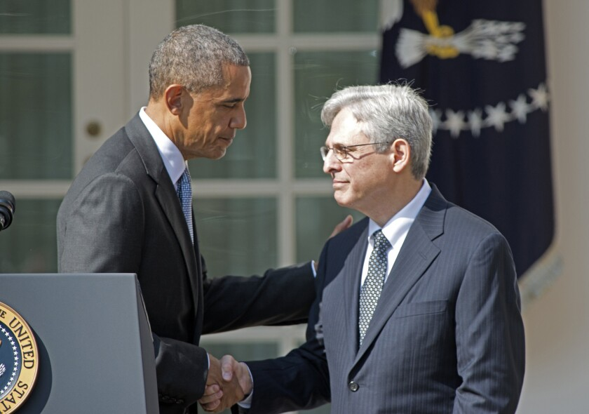 President Obama shakes hands with Judge Merrick Garland after announcing him as his nominee for the Supreme Court on Wednesday.