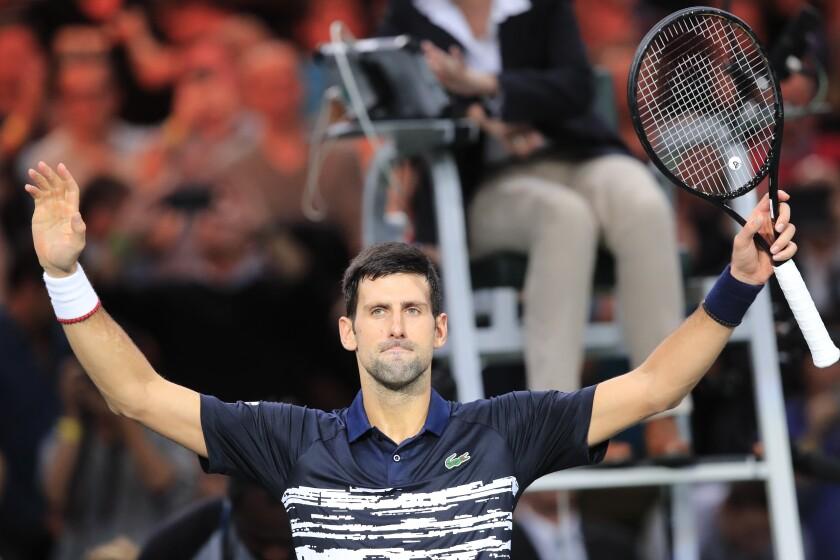 Serbia's Novak Djokovic celebrates after defeating Greece's Stefanos Tsitsipas in a quarterfinal match of the Paris Masters tennis tournament Friday, Nov. 1, 2019 in Paris. (AP Photo/Michel Euler)
