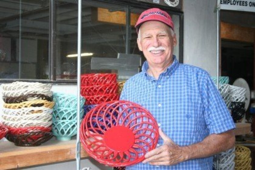 Eucalyptus Stoneware owner John Laver with his iconic handmade baskets. Photo by Kristina Houck