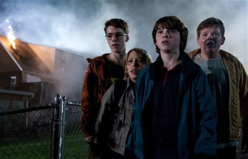 "In this film publicity image released by Paramount Pictures, from left, Gabriel Basso, Ryan Lee, Joel Courtney and Riley Griffiths are shown in a scene from ""Super 8."" (AP Photo/Paramount Pictures, Francois Duhamel)"
