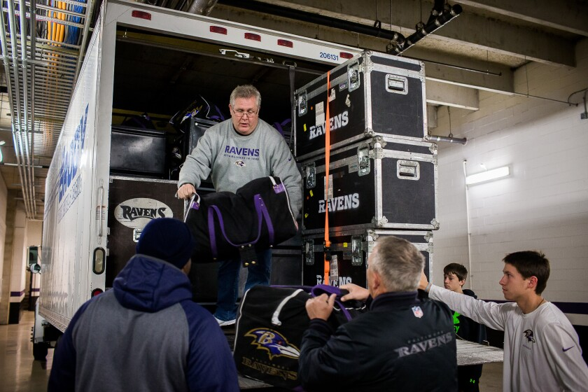 Fireman Jerry Bolling, who works part-time for the Baltimore Ravens,  unloads equipment for the NFL team.