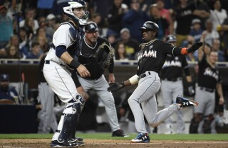 Padres throw game away in extra innings
