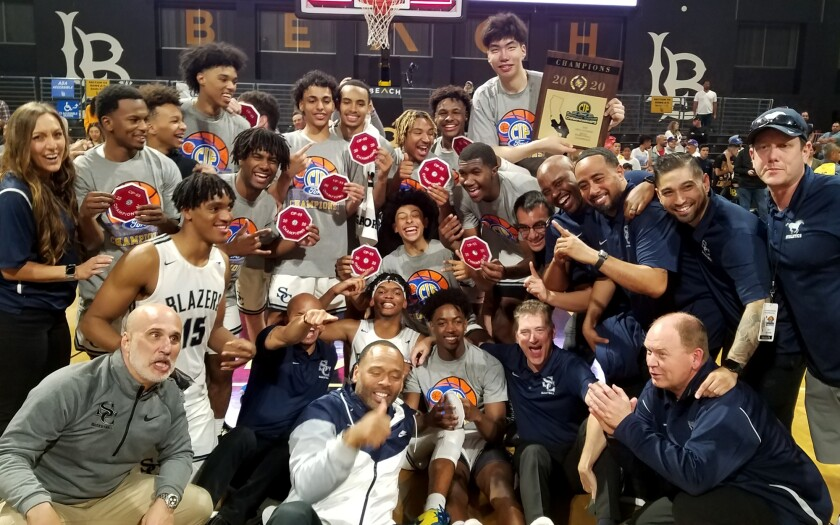 Sierra Canyon players and coaches gather for a photo after defeating Mater Dei for the Southern Section Open Division title on Feb. 28, 2020.