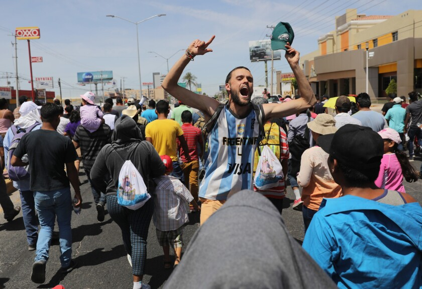 """Central American immigrants, part of an immigrant """"caravan,"""" protest in Hermosillo, Mexico, against President Trump's tweets calling for U.S. Homeland Security to stop them from crossing the border into the United States to request political asylum."""