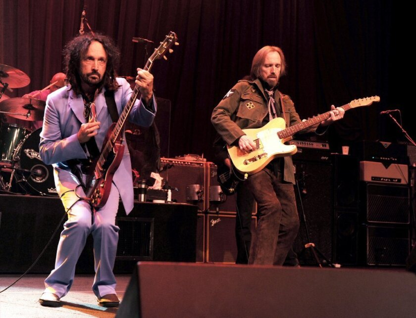 Tom Petty, right, and the Heartbreakers, with musician Mike Campbell perform at the Fonda on June 3, 2013.