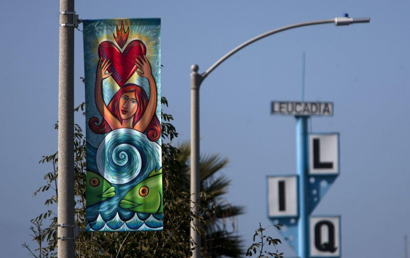 February 18, 2013_Encinitas_|A banner that is part of the Arts Alive program called Dreamer by artist Karob hangs in Leucadia Monday.| Bill Wechter/ U-T San Diego|_Mandatory Photo Credit:Bill Wechter/ U-T San Diego/Copyright 2012 San Diego Union-Tribune, LLC  User Upload Caption: New banners will b