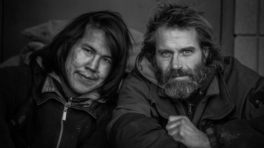 A black-and-white photo captured by Mikey Huff of the Wool Sock Project, which documents the stories of Alaska's homeless population. The Wool Sock Project won the Ultimate Storyteller Contest hosted by North County nature photographer Travis Burke.