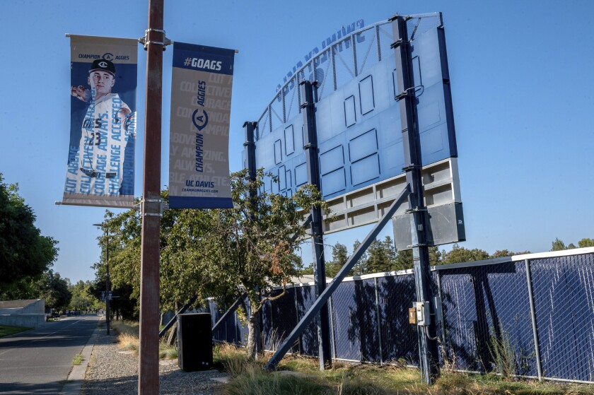 A poster displays a UC Davis baseball player outside the locked Swimley Field on Thursday, July 15, 2021, in Davis, Calif. UC Davis suspended its entire varsity baseball team and put the team's coaching staff on administrative leave Wednesday while it investigates unspecified allegations of misconduct. (Renee C. Byer/The Sacramento Bee via AP)