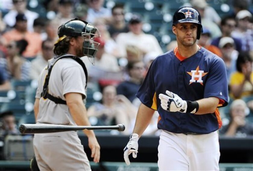 Houston Astros' J.D. Martinez, right, tosses his bat after striking out as Oakland Athletics catcher John Jaso heads to the dugout in the seventh inning of a baseball game on Sunday, April 7, 2013, in Houston. Oakland won 9-3 to sweep the Astros in the three game series. (AP Photo/Pat Sullivan)