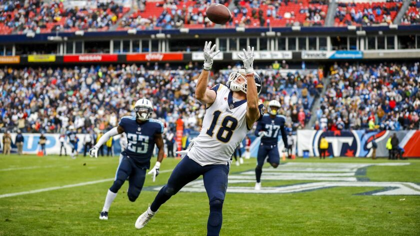 Wide receiver Cooper Kupp of the Los Angeles Rams makes a catch for a touchdown against the Tennessee Titans.