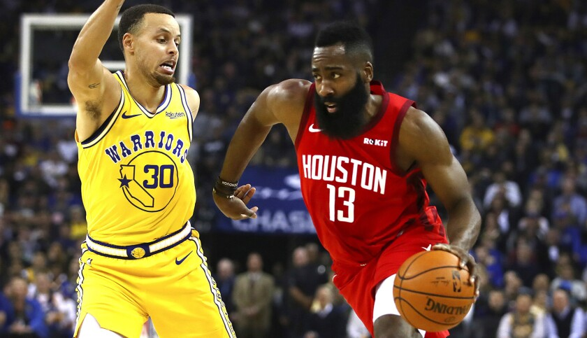 Rockets guard James Harden drives against Warriors guard Stephen Curry during the first half of their game Thursday.