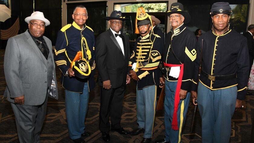 Robert Warren Sr., Larry Thornton, Kenneth Montgomery, August Fimien (president, New Buffalo Soldier