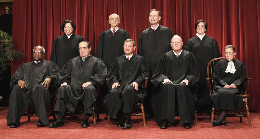 The justices of the U.S. Supreme Court gather for a group portrait in 2010. Seated from left are Associate Justices Clarence Thomas and Antonin Scalia, Chief Justice John G. Roberts Jr., Associate Justices Anthony M. Kennedy and Ruth Bader Ginsburg. Standing from left are Associate Justices Sonia Sotomayor, Stephen Breyer, Samuel A. Alito Jr. and Elena Kagan.