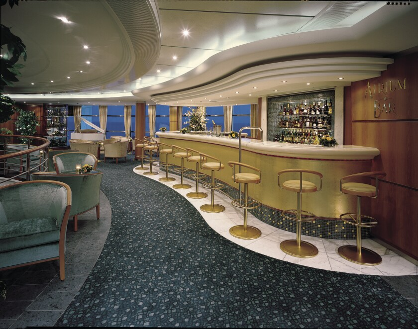 The Atrium Bar aboard the Norwegian Sky. Next January the cruise line will include an open bar in the cost of short cruises from Miami to the Bahamas.
