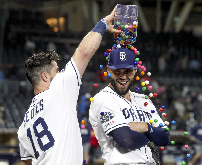 Padres catcher Austin Hedges pours bubble gum over teammate Eric Hosmer after win over Arizona.