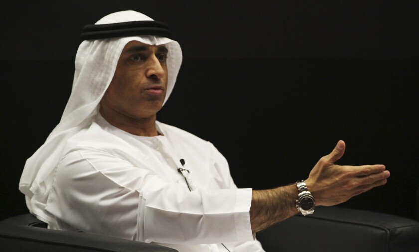 FILE - In this Thursday, Jan. 25, 2018 file photo, Emirati Ambassador to the U.S. Yousef al-Otaiba gestures during an event in Abu Dhabi, United Arab Emirates. The United Arab Emirates played a role in getting longtime Asian rivals India and Pakistan to agree to a cease-fire amid tensions over the disputed region of Kashmir, the Emirati ambassador to Washington said. (AP Photo/Jon Gambrell, File)