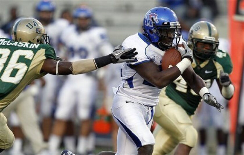 Memphis running back Jerrell Rhodes (22) finds a hole for a big run past UAB defender Elliott McGaskin (36) during the first half of an NCAA college football game on Saturday, Nov. 20, 2010, in Birmingham, Ala. (AP Photo/Butch Dill)