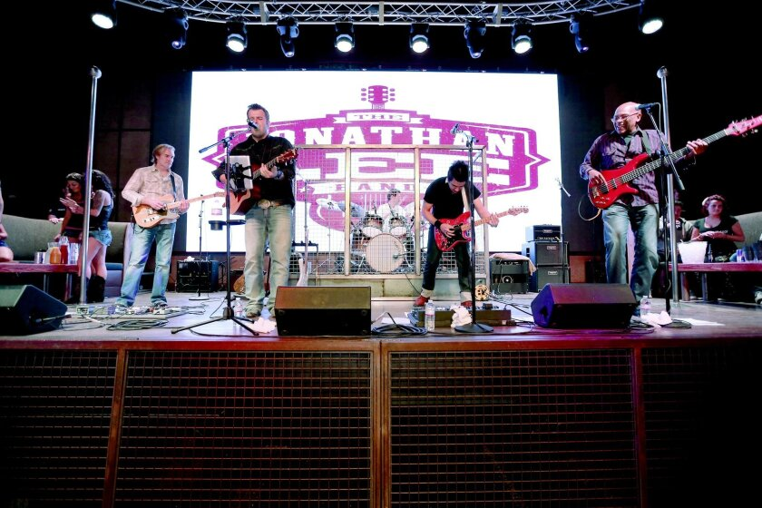 It's country and rock Wednesdays through Sundays at Moonshine Flats, 344 Seventh Ave., where club music takes over after midnight. Patrick Samokhvalof