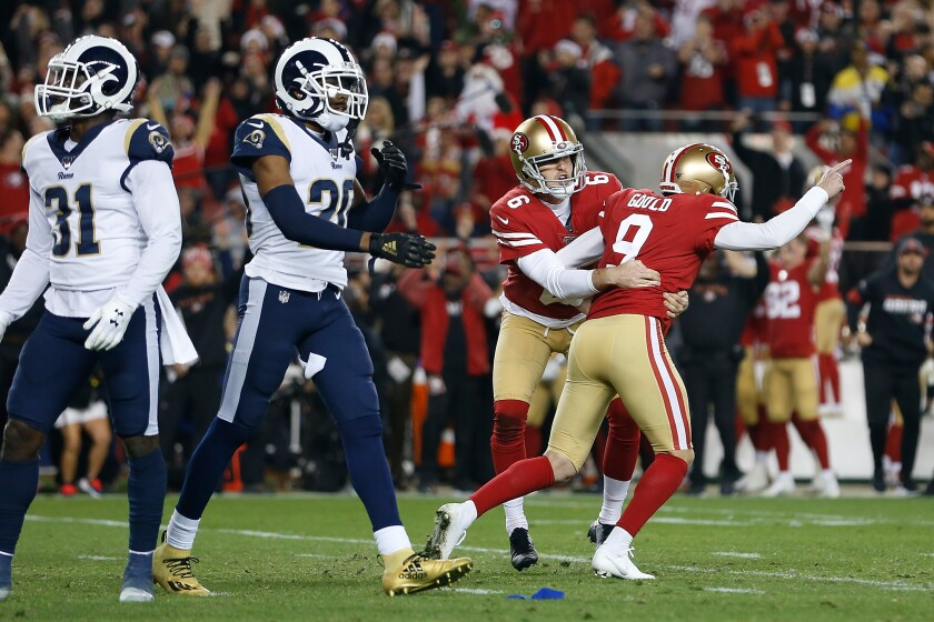 The Rams' Darious Williams (31) and Jalen Ramsey react as the 49ers' Robbie Gould celebrates his game-winning field goal Dec. 21, 2019.