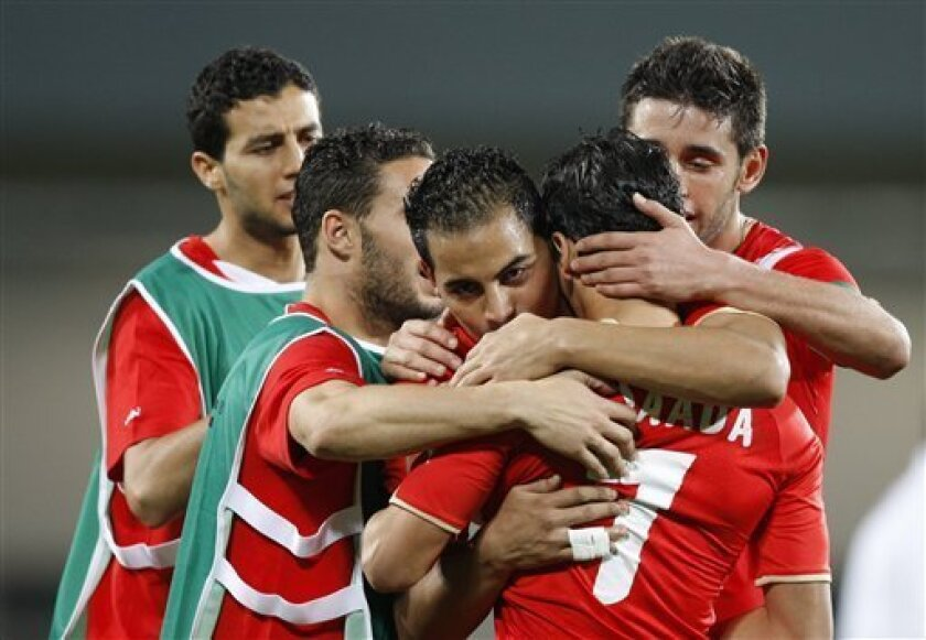 Tunisia players console each other after drawing 1-1 with Zambia in their African Cup of Nations Group D soccer match at Tundavala Stadium in Lubango, Angola Wednesday, Jan. 13, 2010. (AP Photo/Rebecca Blackwell)