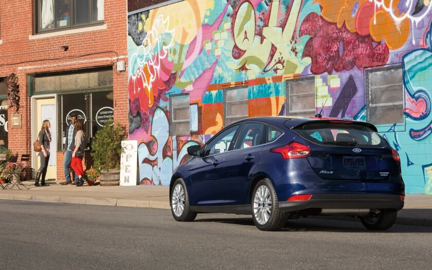 This photo provided by Ford shows the 2016 Ford Focus Titanium hatchback. Ford's jack-of-all-trades Focus hatchback adds a racy RS model for 2016, offers more safety features than ever and now has an easier, more responsive voice-recognition system for making phone calls and sending texts. (Courtes