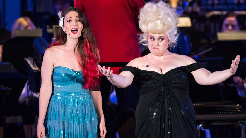 "Sara Bareilles, left, sings the role of Ariel, with Rebel Wilson in the role of Ursula at opening night of ""Disney's The Little Mermaid in Concert"" at the Hollywood Bowl."