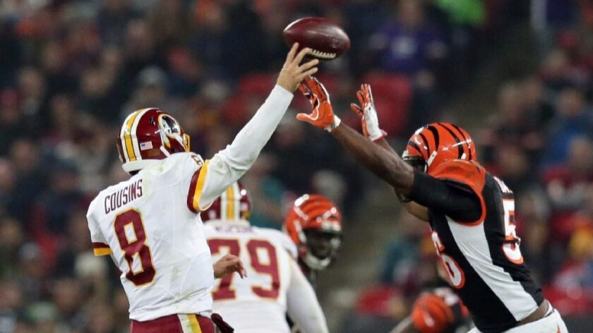 Bengals linebacker Karlos Dansby (56) tries to block the throw of Redskins quarterback Kirk Cousins during a game in London on Oct. 30.