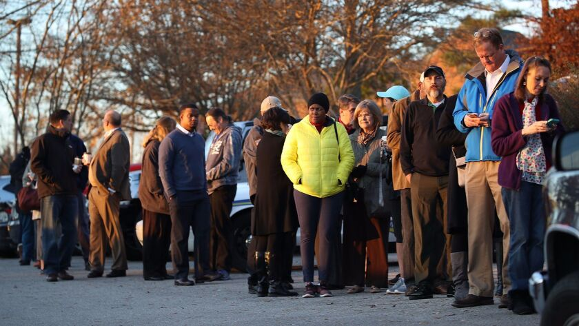 Voters wait in line to cast their ballots at a polling station in Birmingham, Ala., on Tuesday.