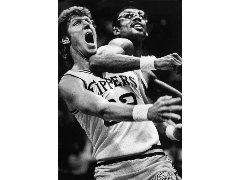 Nov. 2, 1983: Two former UCLA greats, Bill Walton, left, and Kareem Abdul-Jabbar, mix it up under the basket in an NBA game at San Diego.