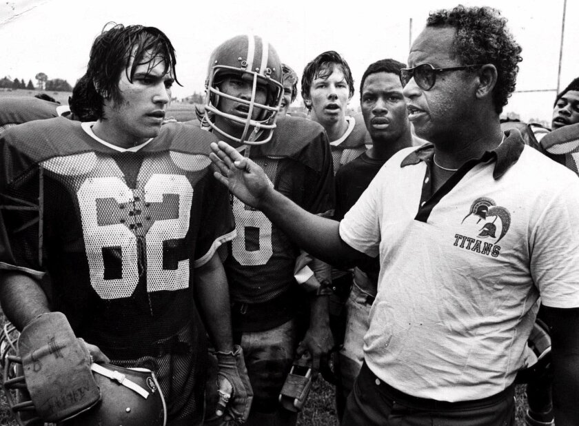 """Herman Boone instructs his players at Virginia's T.C. Williams High School in the championship year of 1971. Boone, the coach who inspired the movie """"Remember the Titans,"""" has died."""