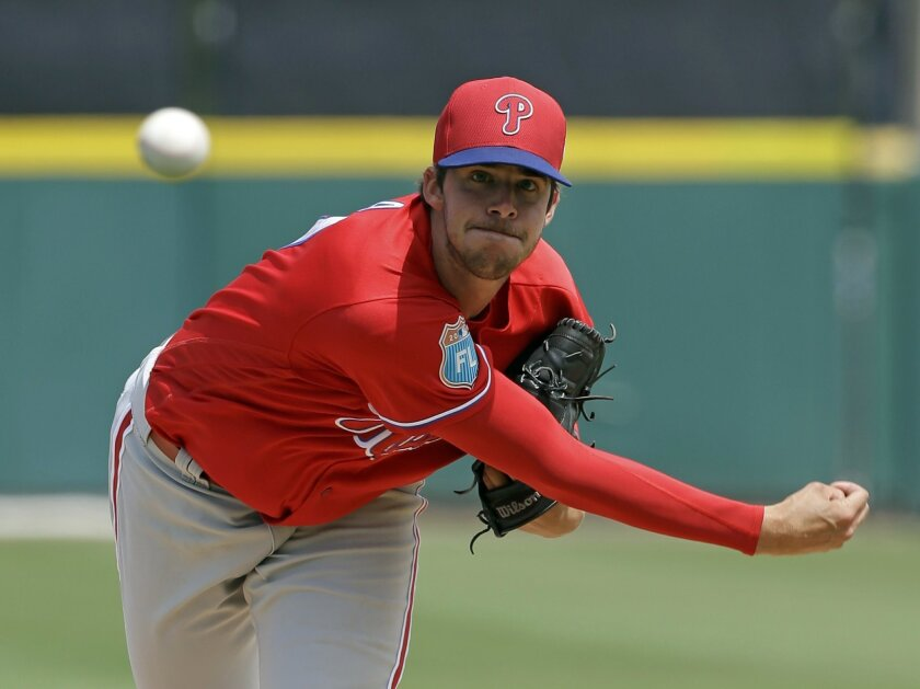 Philadelphia Phillies' Aaron Nola pitches against the Detroit Tigers in the third inning of spring training baseball game, Monday, March 21, 2016, in Lakeland, Fla. (AP Photo/John Raoux)