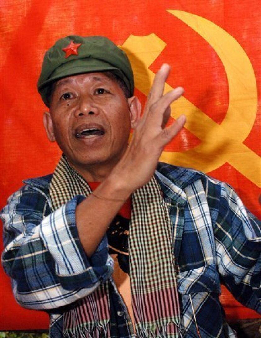 """FILE - In this file photo taken Tuesday, Jan. 6, 2004, rebel spokesman Gregorio Rosal gestures as he talks to journalists during a clandestine news conference in a communist New People's Army encampment in northern Luzon, Philippines. The outlawed Communist Party of the Philippines said Sunday, Oct. 9, 2011, that Gregorio """"Comrade Roger"""" Rosal died in a guerrilla zone on June 22 of a heart attack. He was 64. The popular Philippine communist guerrilla served as the movement's spokesman for years and gave a face to one of Asia's longest-running Marxist insurgencies. (AP Photo/Pat Roque, File)"""