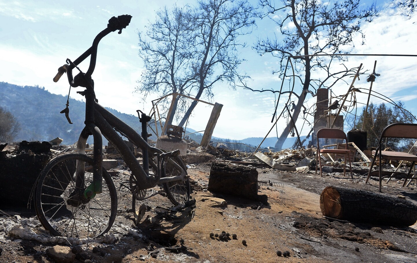 A child's bike sits among the ruins of a burned home destroyed in a wildfire along Highway 41 outside Oakhurst, Calif.